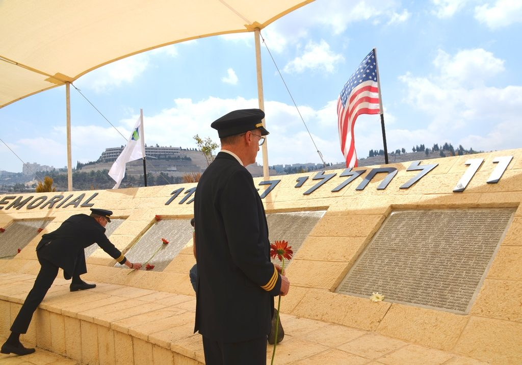 United Airline pilots place flowers at memorial for victims of September 11