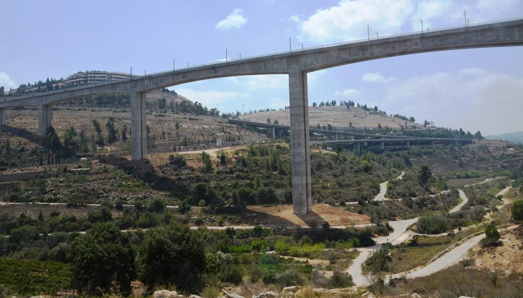 View of fast rain bridge from park near September 11 memorial in hills of Jerusalem Israel