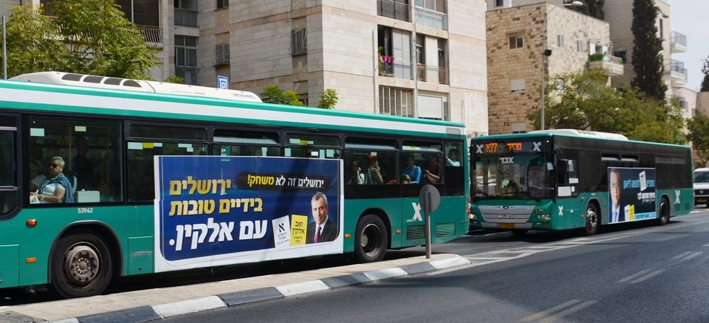 Campaign signs for Elkin and Lion on side of Jerusalem Israel bus