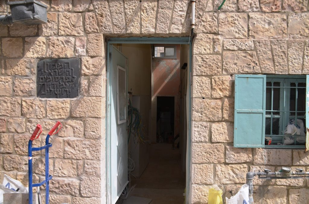 Door open with workers redoing house in Jerusalem