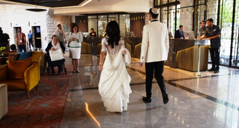 Bride and groom in Inbal lobby Jerusalem Israel