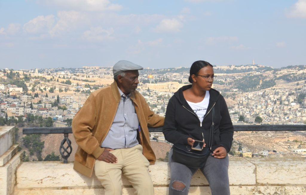 Ethiopian Israeli man and woman with view of Jerusalem in background