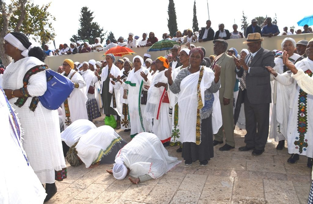 Ethiopian Sigd holiday and women praying.