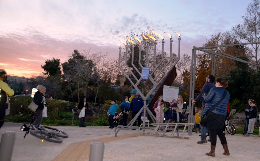 Lighting a large menorah on last night of Chanuka in Jerusalem Israel