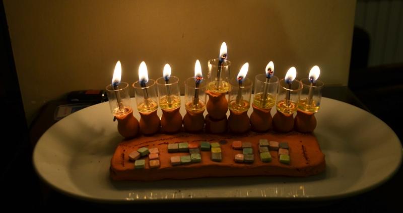 Hanukkah menorah lit on last night