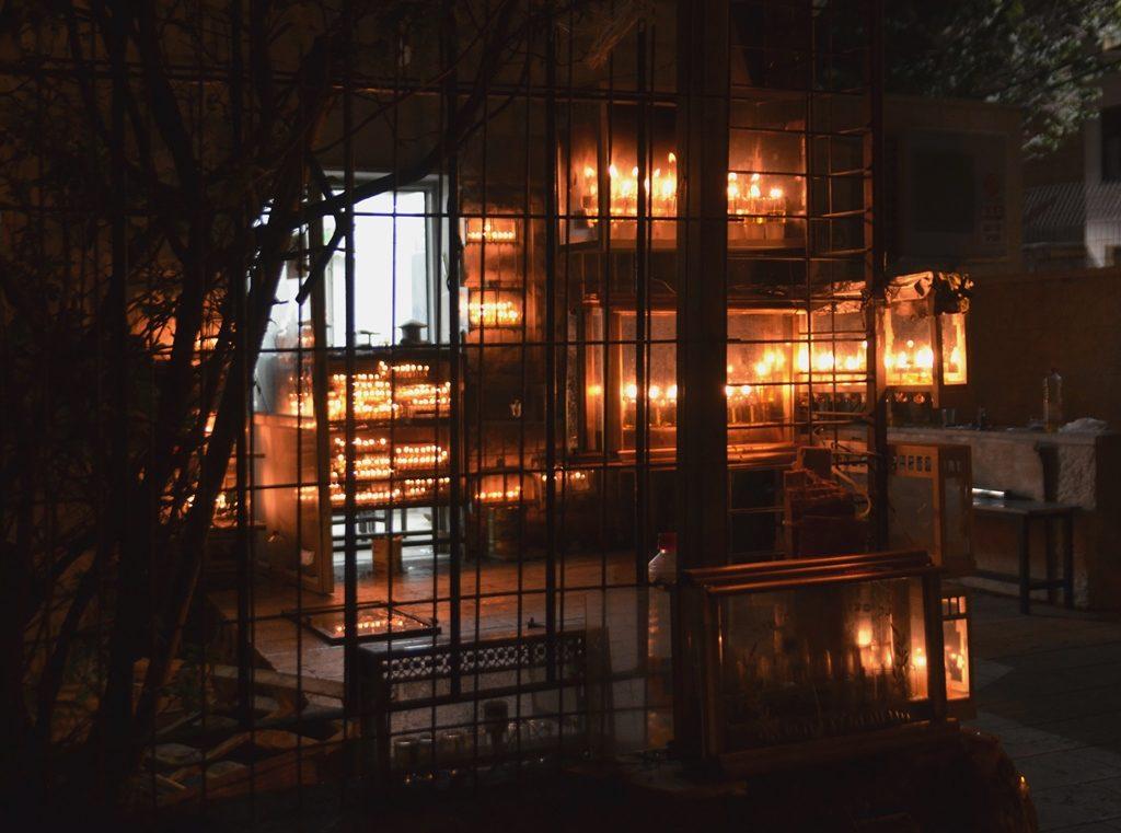 Yeshiva in Jerusalem with Hanukkah menorahs lit outside