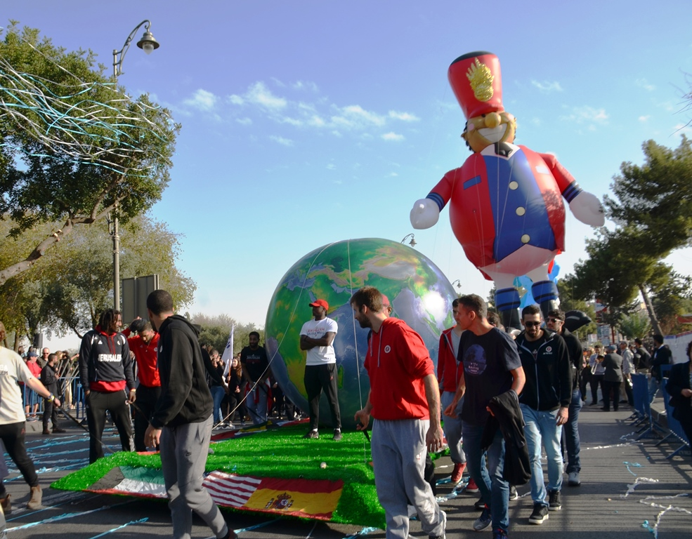 Float in Jerusalem Hanukkah parade with basketball players