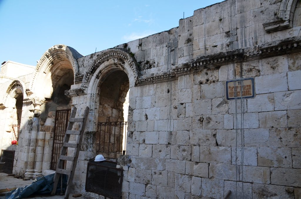 Wall of destroyed Tiferet Israel synagogue beginning repair