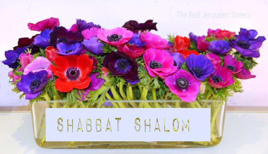 Shabbat Shalom on flowers in vase