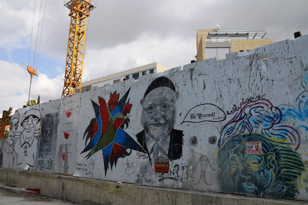 Jerusalem Israel construction fence with graffiti