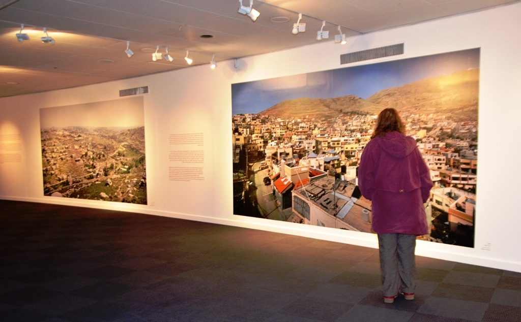 Woman looking at photos at Islamic Museum in Jerusalem Israel