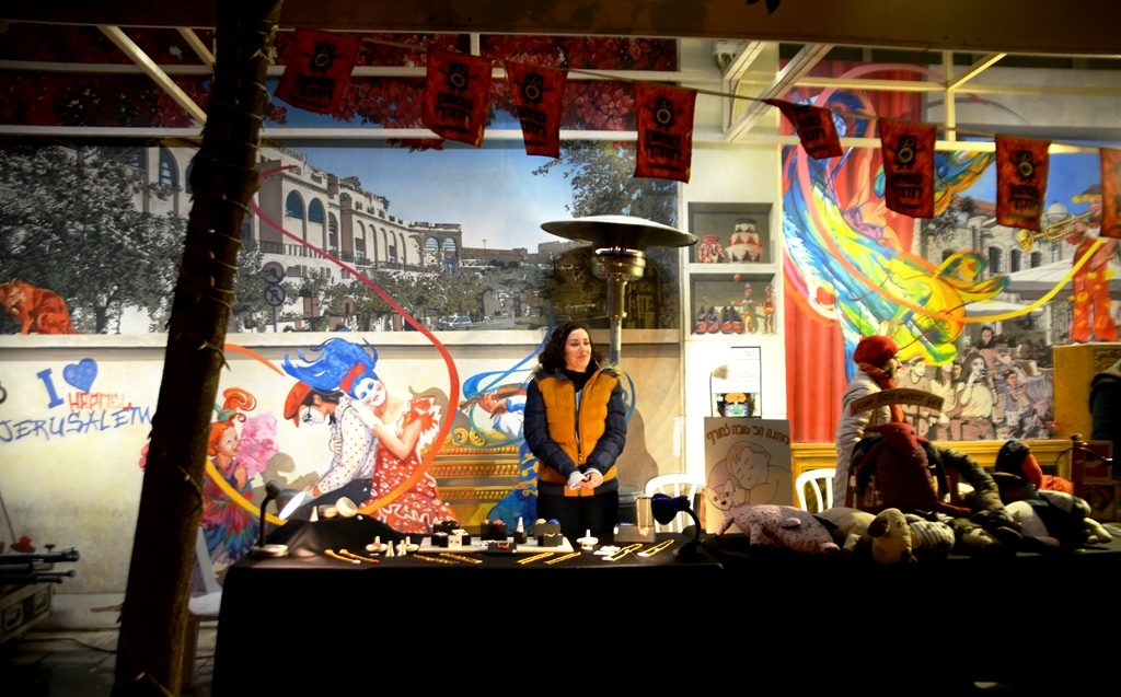 Art for sale at festival in jerusalem at night in winter
