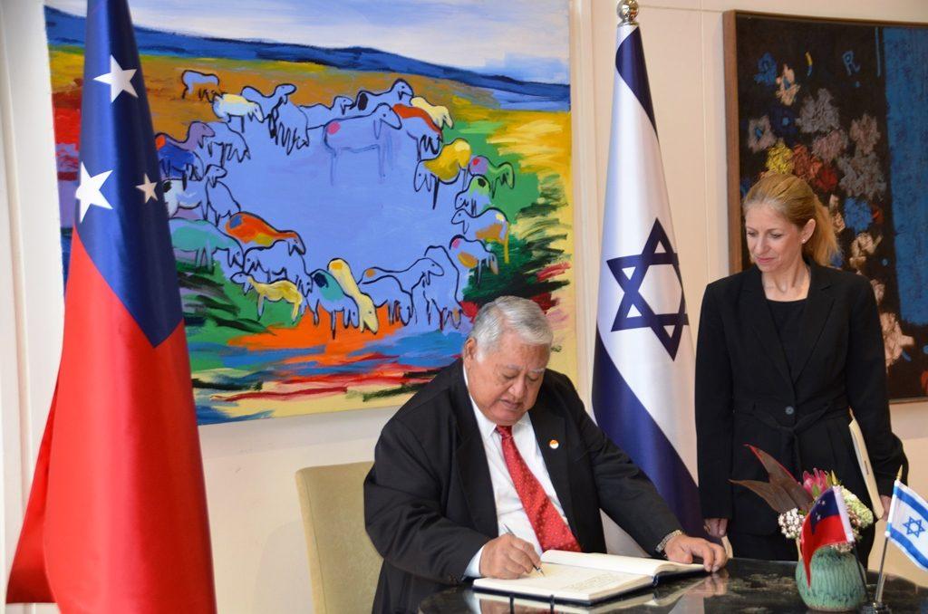 Prime Minister of Samoa in Jerusalem Israel signing official guest book