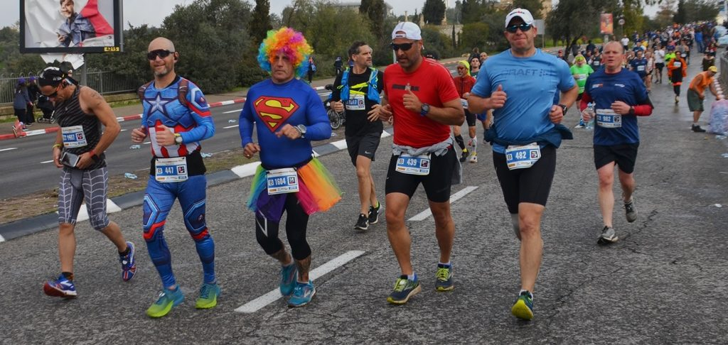 Jerusalem marathon runners in costumes