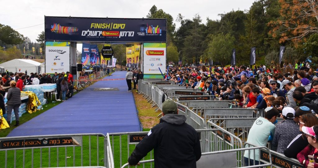 Crowd waiting for full marathon winner to cross finish line