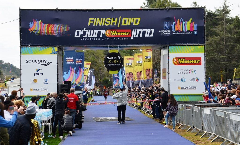 Jerusalem mayor Moshe Lion at finish line when first place runner of Jerusalem marathon arrives