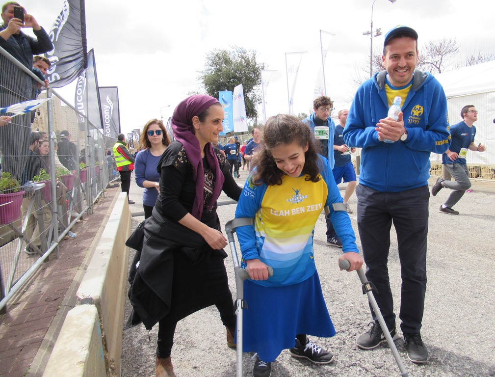 Leah ready to cross finish line of Jerusalem marathon