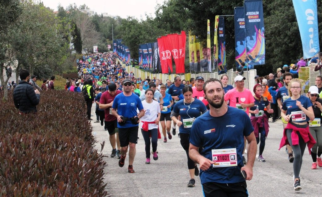 Runners near finish line of Jerusalem marathon for 10K races