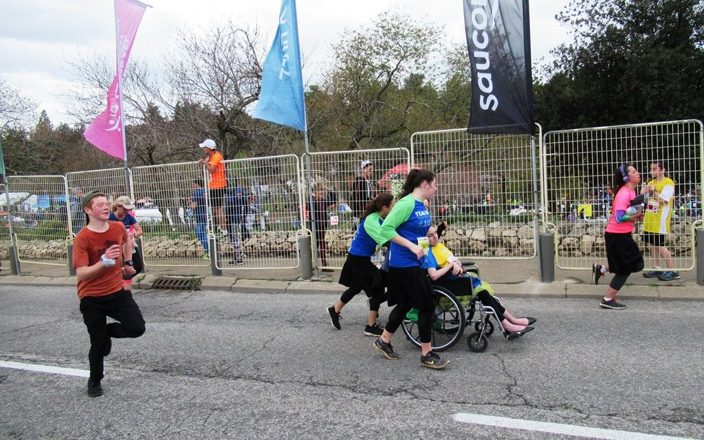 Pushing a wheelchair in race Jerusalem, Marathon