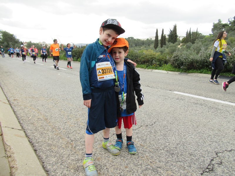 Two young runners in Jerusalem marathon on way to family walk