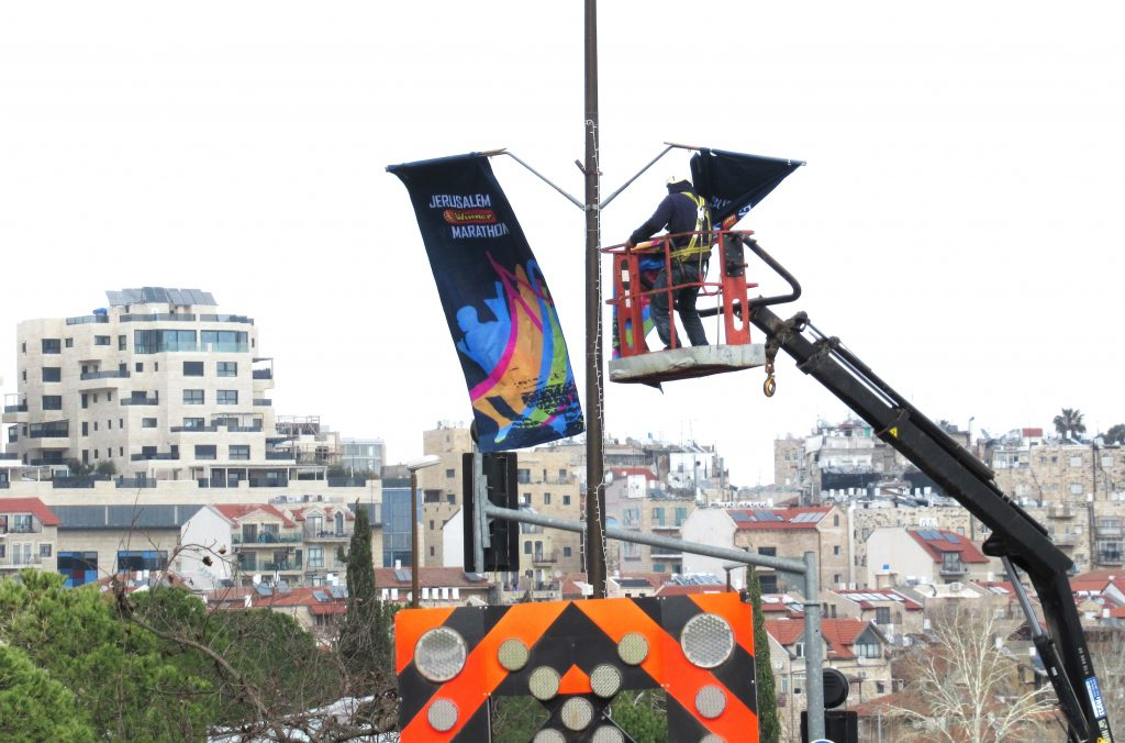 Hanging banners for jerusalem marathon