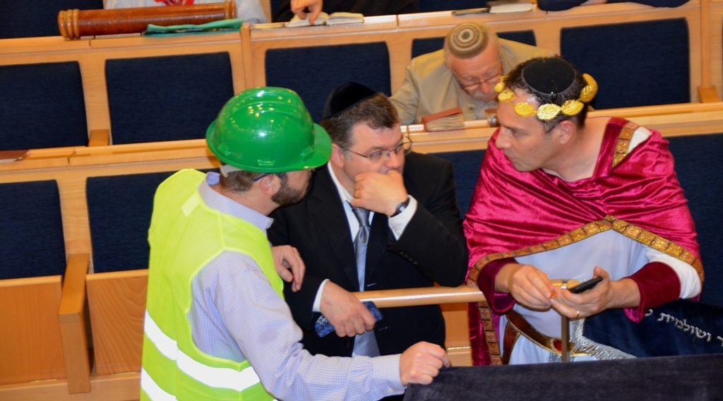 Jerusalem men in costume for Purim meglla reading