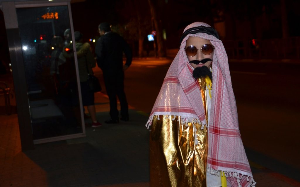 Costume on Jerusalem Israel street at night of Purim