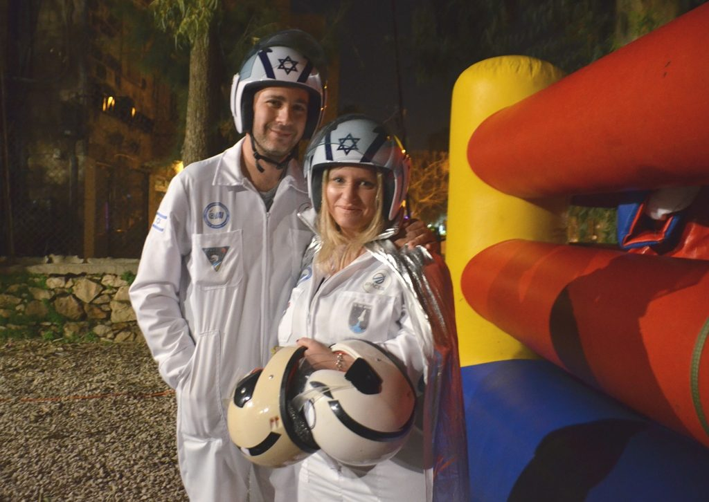 Jerusalem couple dressed in space suits for Purim