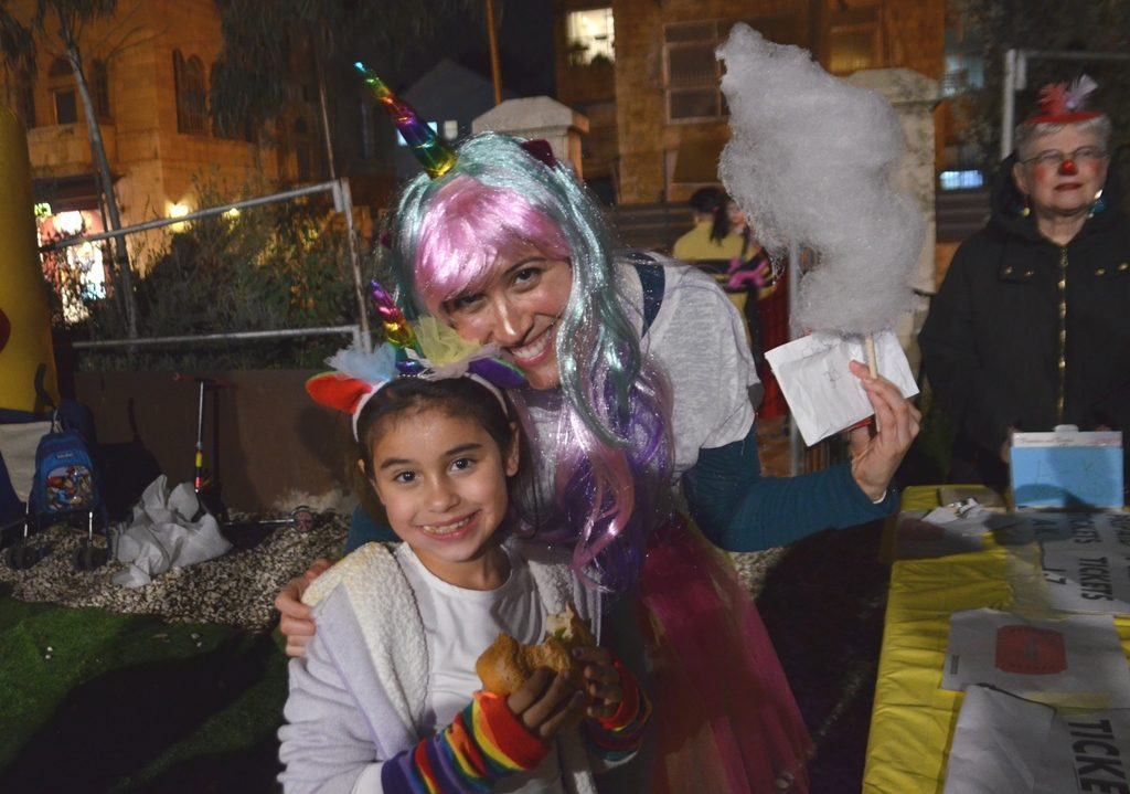 Unicorn costumes popular in Jerusalem for Purim