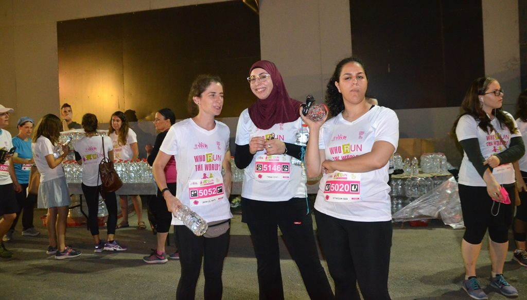 young women running in Jerusalem women's night race