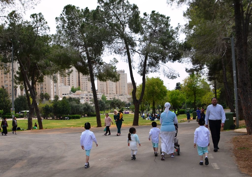 Sacher Park in Jerusalem on Pesach, family in matching outfits