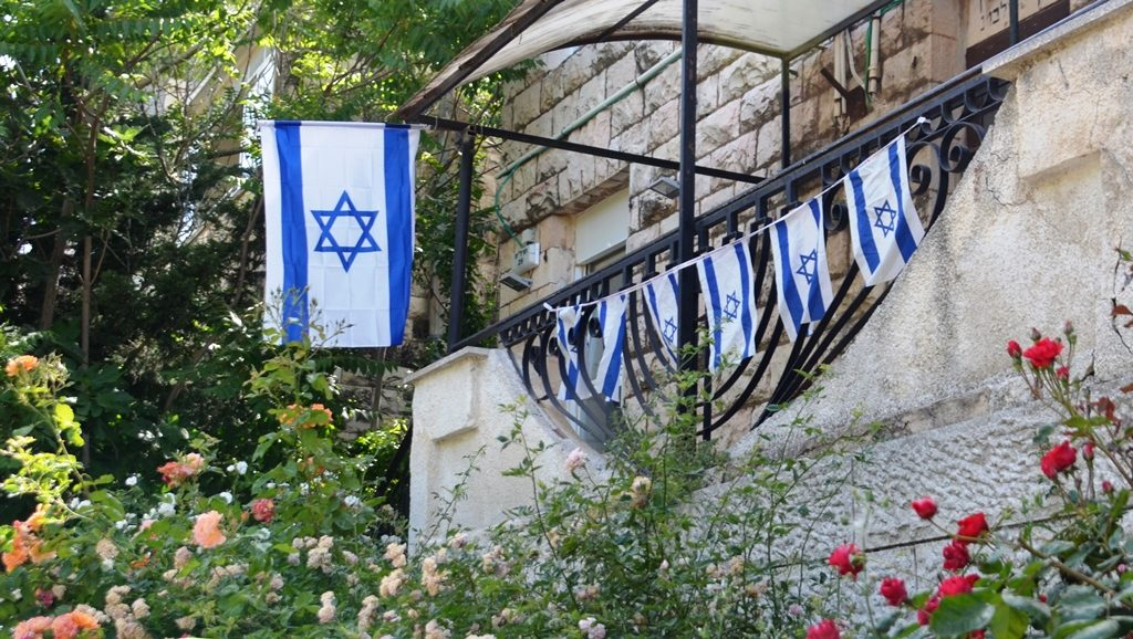 Jerusalem synagogue with Israeli flags in front