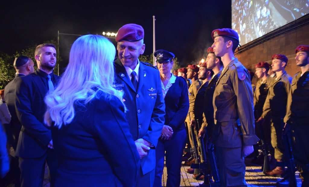 Holocaust Remembrance Day ceremony at Yad Vashem head of IDF speaking with Sara Netanyahu
