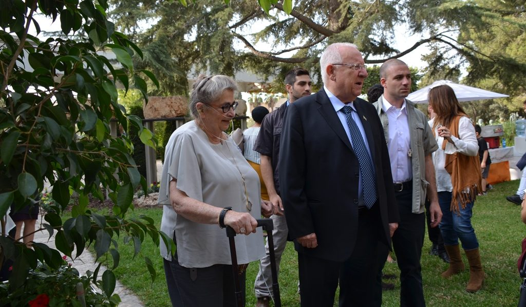 Nechama Rivlin with her oxygen in garden at Beit Hanasi
