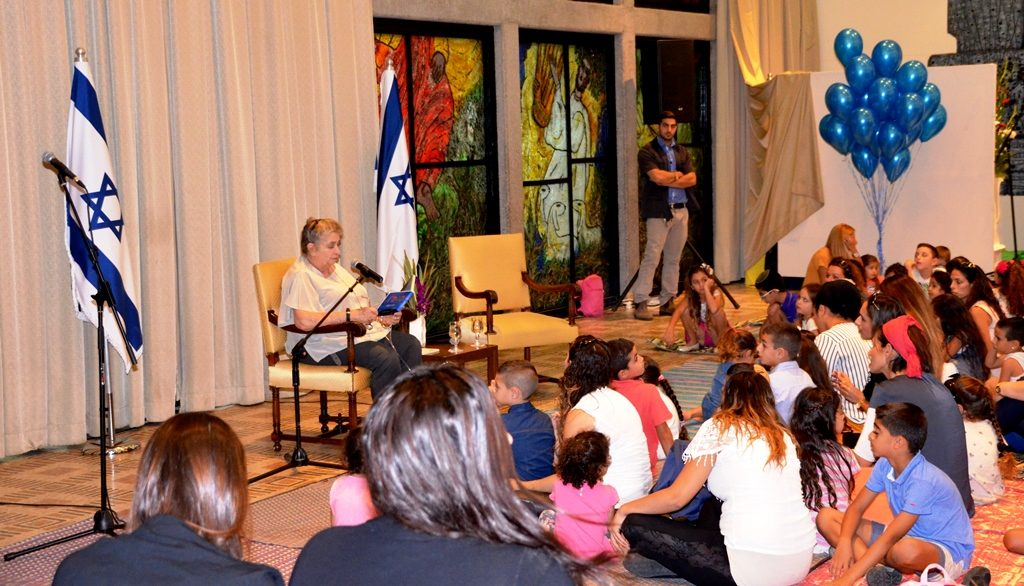 Beit Hanasi party with Nechama Rivlin reading to children