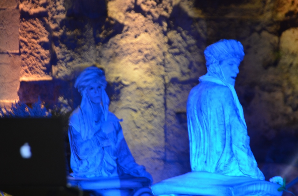 Woman and man dressed as statutes at nigh event in Caesrea to launch new visitor center