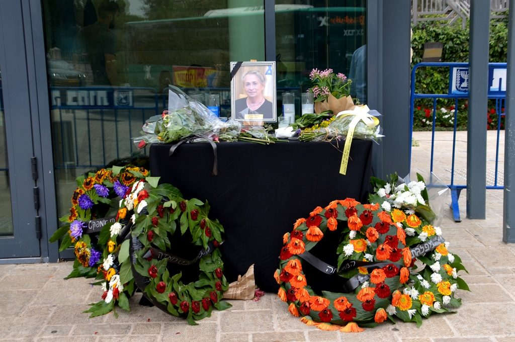 Necjama Rivlin funeral mourning wreathes and candle