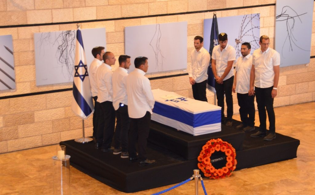 Jerusalem Theater lobby before funeral of Nechama Rivlin pall bearers bring casket and stand before leaving