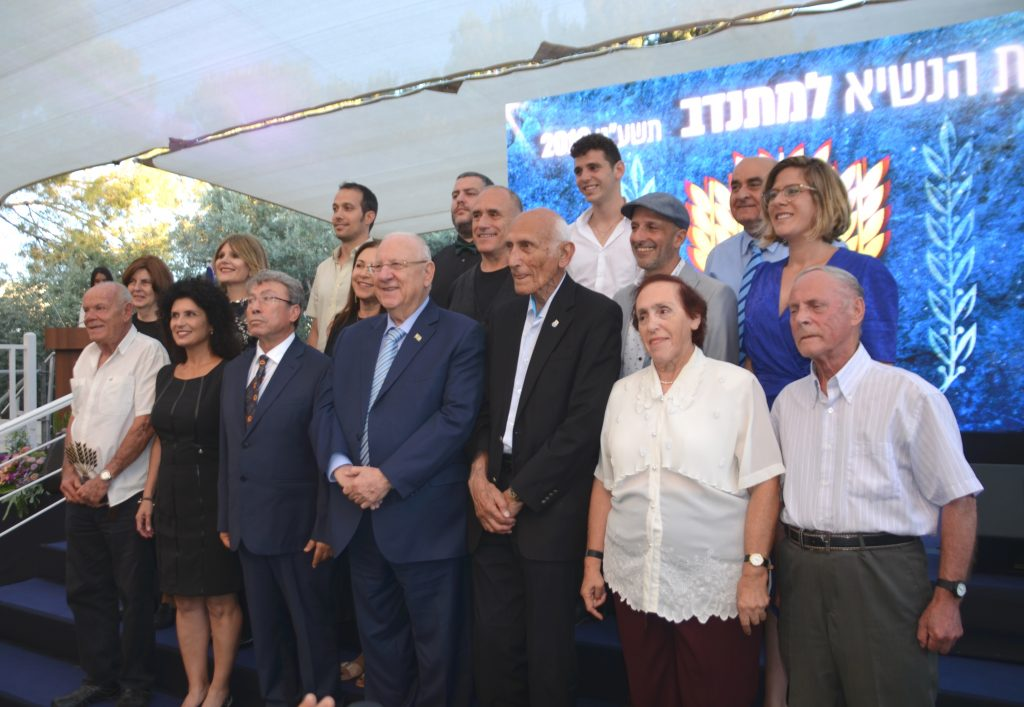 President Rivlin and winners of volunteer awards at ceremony in garden of Beit Hanasi