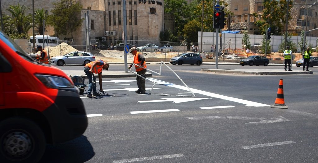Jerusalem Gateway traffic changed men painted arrows on road
