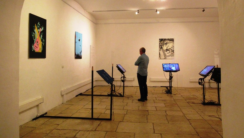 Man looking at exhibit in Hansen House for an illustration festival called Outline