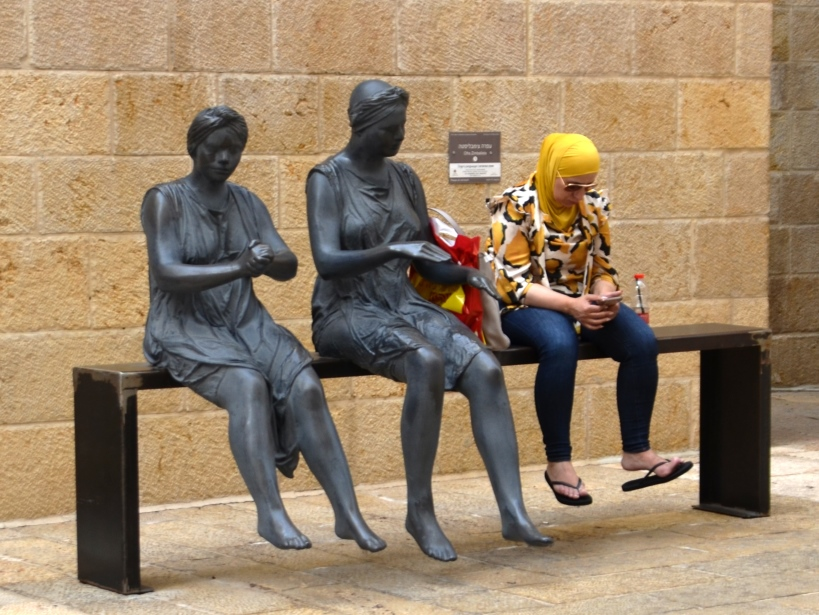 Mamilla Mall Jerusalem Israel art piece with Arab girl sitting