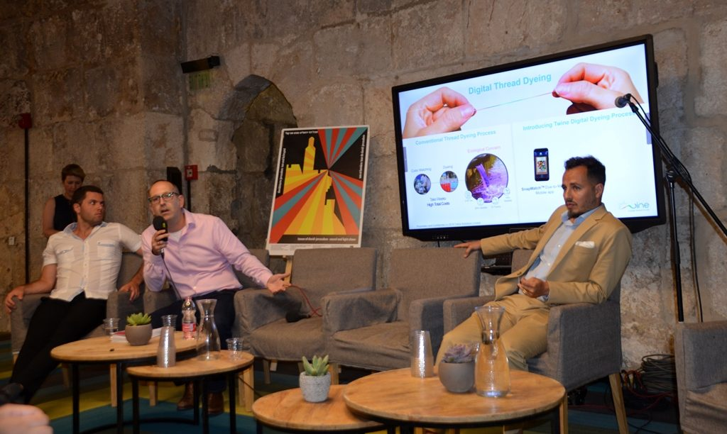 Dyeing by nanotechnology explained at OVERALL fashion event in Jerusalem Israel