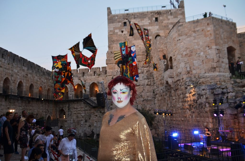 Jerusalem Tower of David fashion event woman wearing mask