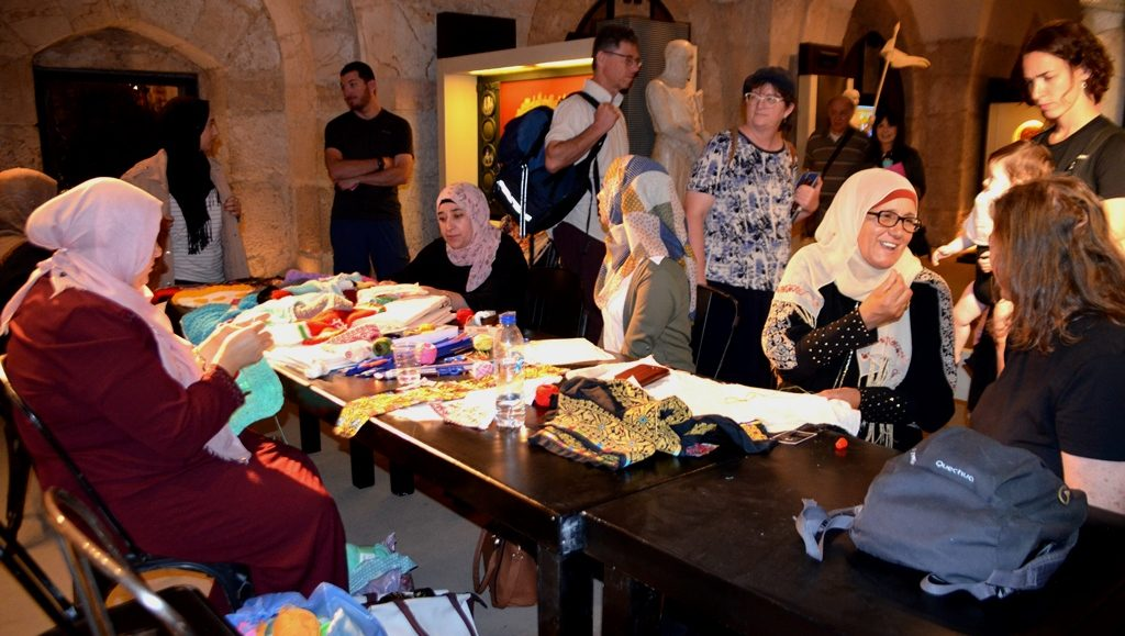 Arab women sewing in Tower of David for Overall fashion event