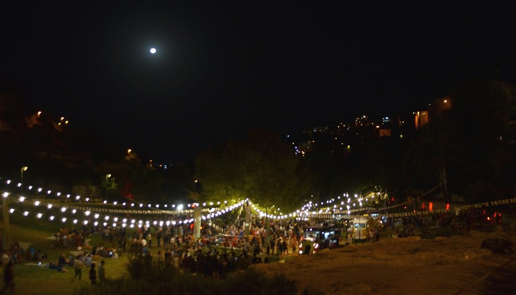 Jerusalem Food Truck Festival in Hinnon Valley at night with full moon