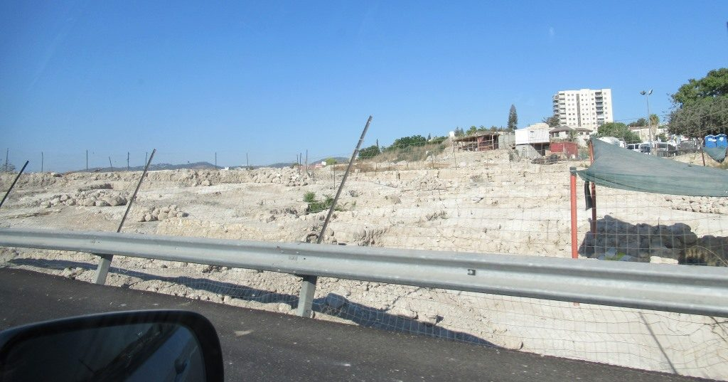 Side of road where ancient site was found next to new road in BEeit Shemesh