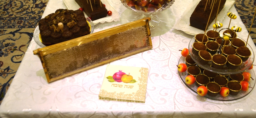 Table with honey and cakes and Shana tova, New Year Rosh Hashana