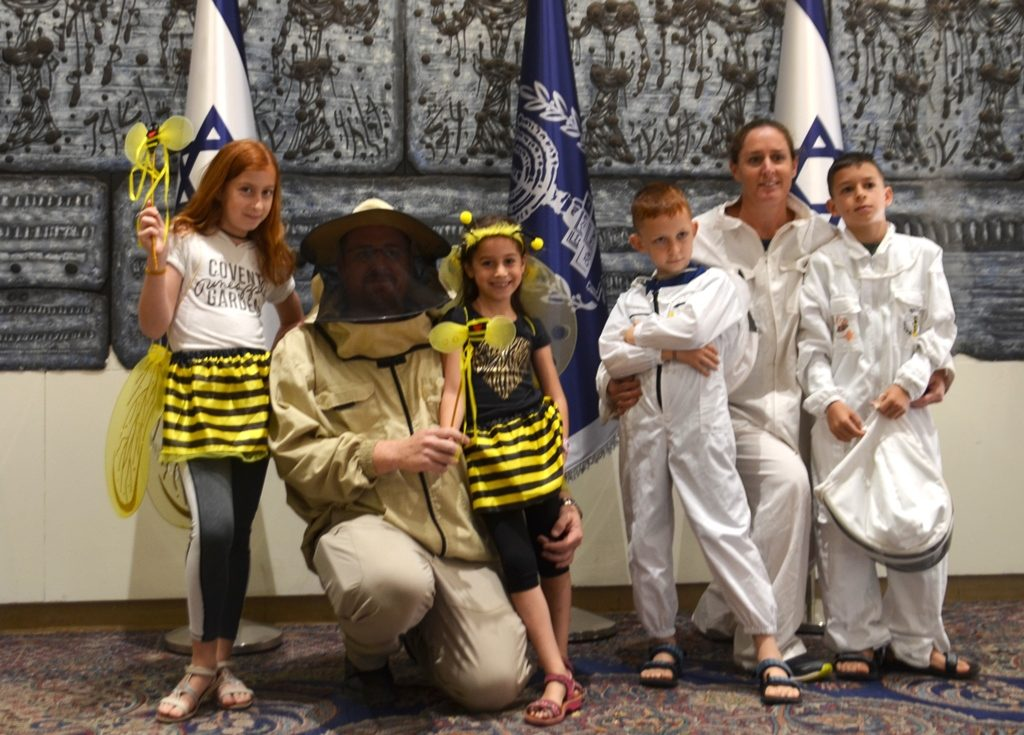Family of beekeeper at Beit Hanasi before the New Year.
