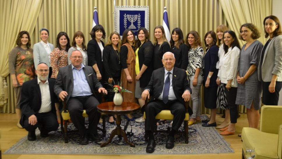 Beit Hanasi President Rivlin posing with women form Movilot